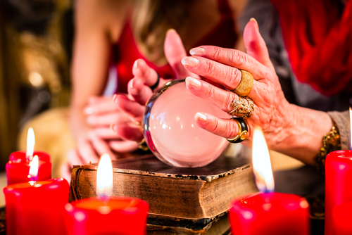 Woman's hands around a crystal ball