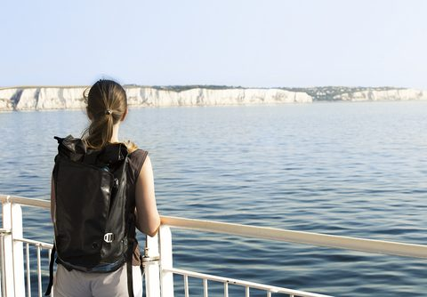 Woman looking at the White Cliffs of Dover